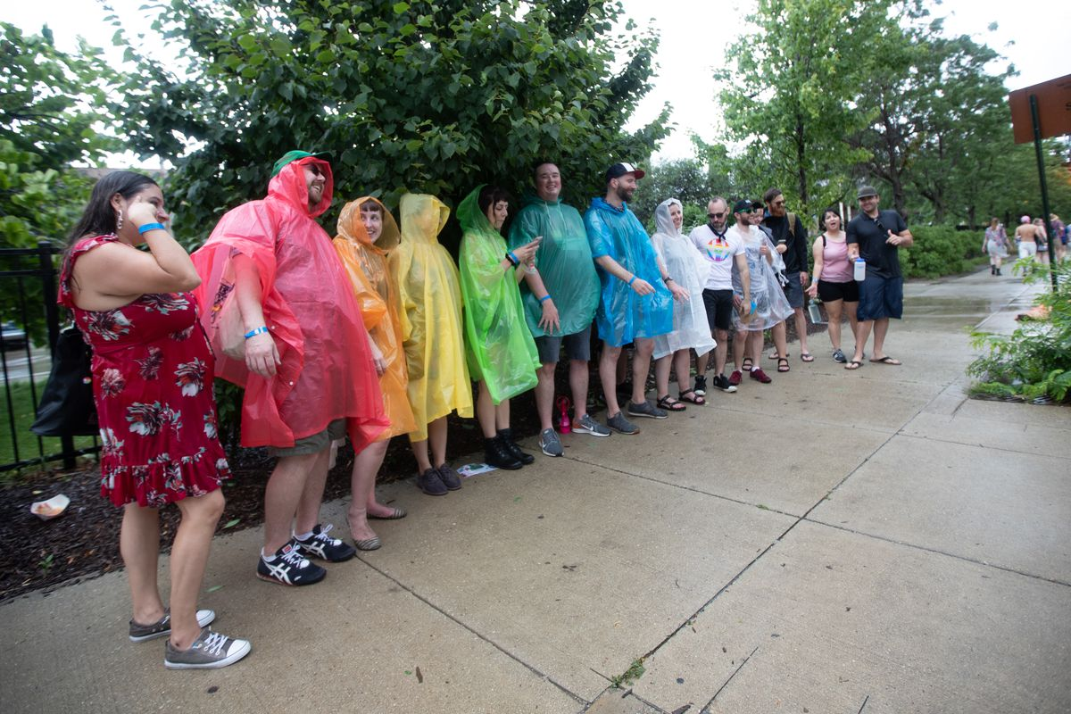 Fans wait out the rain at Pitchfork Music Festival on Saturday, July 20, 2019 outside Union Park.