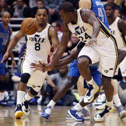 Randy Foye, left, and Paul Millsap of the Utah Jazz run for a loose ball during NBA basketball in Salt Lake City, Monday, Jan. 7, 2013.