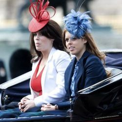 LONDON - JUNE 12:  Princess Beatrice (right) and Princess Eugenie ride a carriage down the Mall during Trooping The Colour on June 12, 2010 in London, England. Trooping The Colour is the Queen's annual birthday parade and dates back to the time of Charles