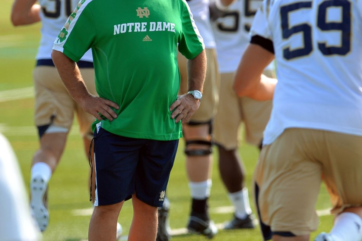 Aug. 4, 2012; South Bend, IN, USA; Notre Dame Fighting Irish head coach Brian Kelly watches practice at the LaBar Practice Complex. Mandatory Credit: Matt Cashore-US PRESSWIRE