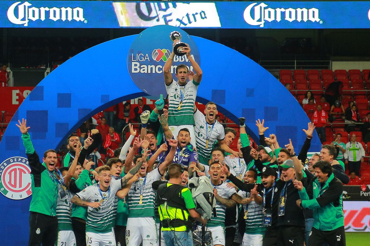 394783ba070 ... Championship trophy with teammates after the Final second leg match  between Toluca and Santos Laguna as part of the Torneo Clausura 2018 at  Nemesio Diez ...