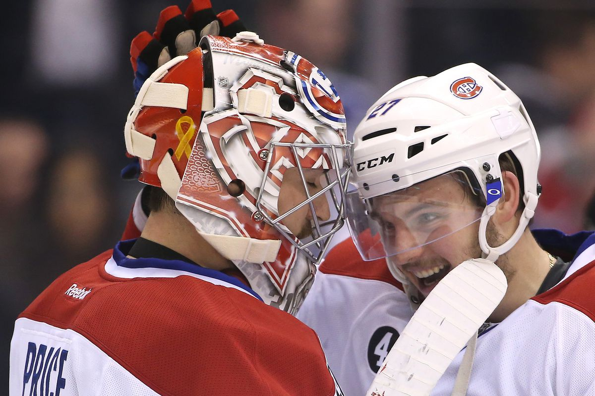 Apr 11, 2015; Toronto, Ontario, CAN; Montreal Canadiens goalie Carey Price (31) is congratulated by center Alex Galchenyuk (27) after their victory in the shootout against the Toronto Maple Leafs at Air Canada Centre.