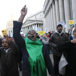 Fatima Akbar, center, marches with her son Shafiyu, 11,  left, and Ayesha Mohammed, right, towards the New York Police Department headquarters during a rally asking for the resignation of NYPD Commissioner Ray Kelly and NYPD spokesperson Paul Browne, in a demand for independent community control of the NYPD, and a well-funded oversight mechanism with subpoena power, Friday, Feb. 3, 2012 in New York.  Thirty-three civil rights groups from around America complained to the New York attorney general Friday about police documents that showed the New York Police Department recommending increased surveillance of Shiite mosques based solely on their religion. The letter urged Attorney General Eric Schneiderman to investigate NYPD's surveillance operations, which monitored entire neighborhoods and built databases about everyday life in Muslim communities.