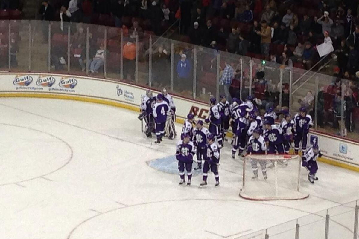 Holy Cross players celebrate the 5-4 upset victory over Boston College.