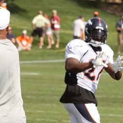 Knowshon Moreno turns to catch a pass from his running back coach.