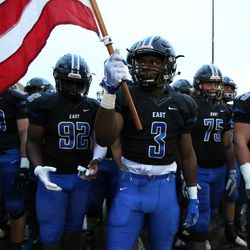 Lincoln-Way East's A.J. Henning (3) carries the flag. Allen Cunningham/For the Sun-Times.