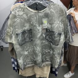 Sheer floral top with pockets, $65