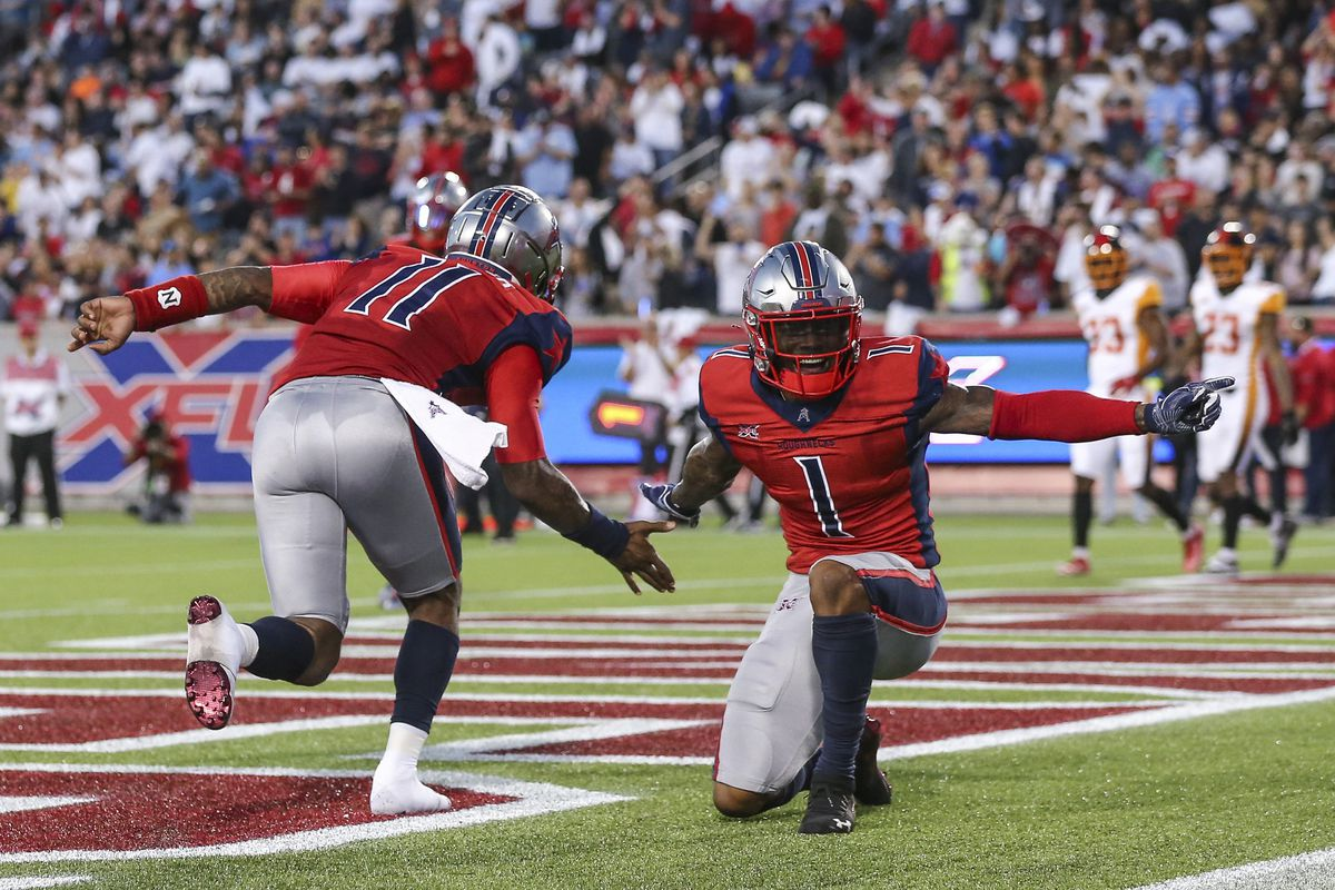 Houston Roughnecks quarterback P.J. Walker and wide receiver Kahlil Lewis celebrate after scoring a two-point conversion against the Los Angeles Wildcats during the third quarter in a XFL football game at TDECU Stadium.