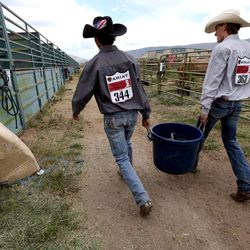 Dylan Watterson and Dawson Zaharias carry water between sessions of the Utah High School Rodeo Finals at the Wasatch County Events Complex in Heber City on Thursday, June 1, 2017.