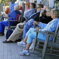 In this photo taken Friday, Sept. 14, 2012, guests sit on the veranda at the historic Star Island Family Retreat and Conference Center at the Isle of Shoals in Rye, N.H. The hotel 10 miles off the coast of New Hampshire wants to establish itself as an environmental leader. The island is essentially a self-contained system, and it is an ideal spot to showcase energy innovations and could be become a model for other communities.