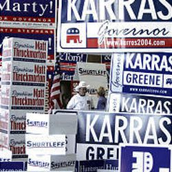 Delegates and attendees at the Republican nominating convention are lost in a sea of campaign signs.
