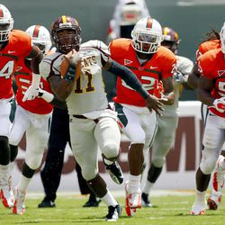 Bethune-Cookman quarterback Brodrick Waters (11) scrambles with the ball against Miami in the first half of an NCAA college football game, Saturday Sept. 15, 2012, in Miami.