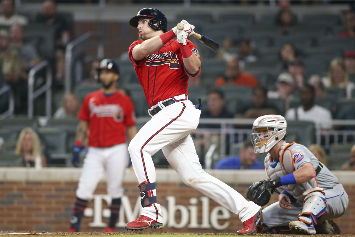 Atlanta Braves first baseman Austin Riley (27) hits a single against the New York Mets in the eighth inning at Truist Park.