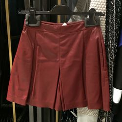 Bordeaux pleated shorts, $555 (was $1,850)