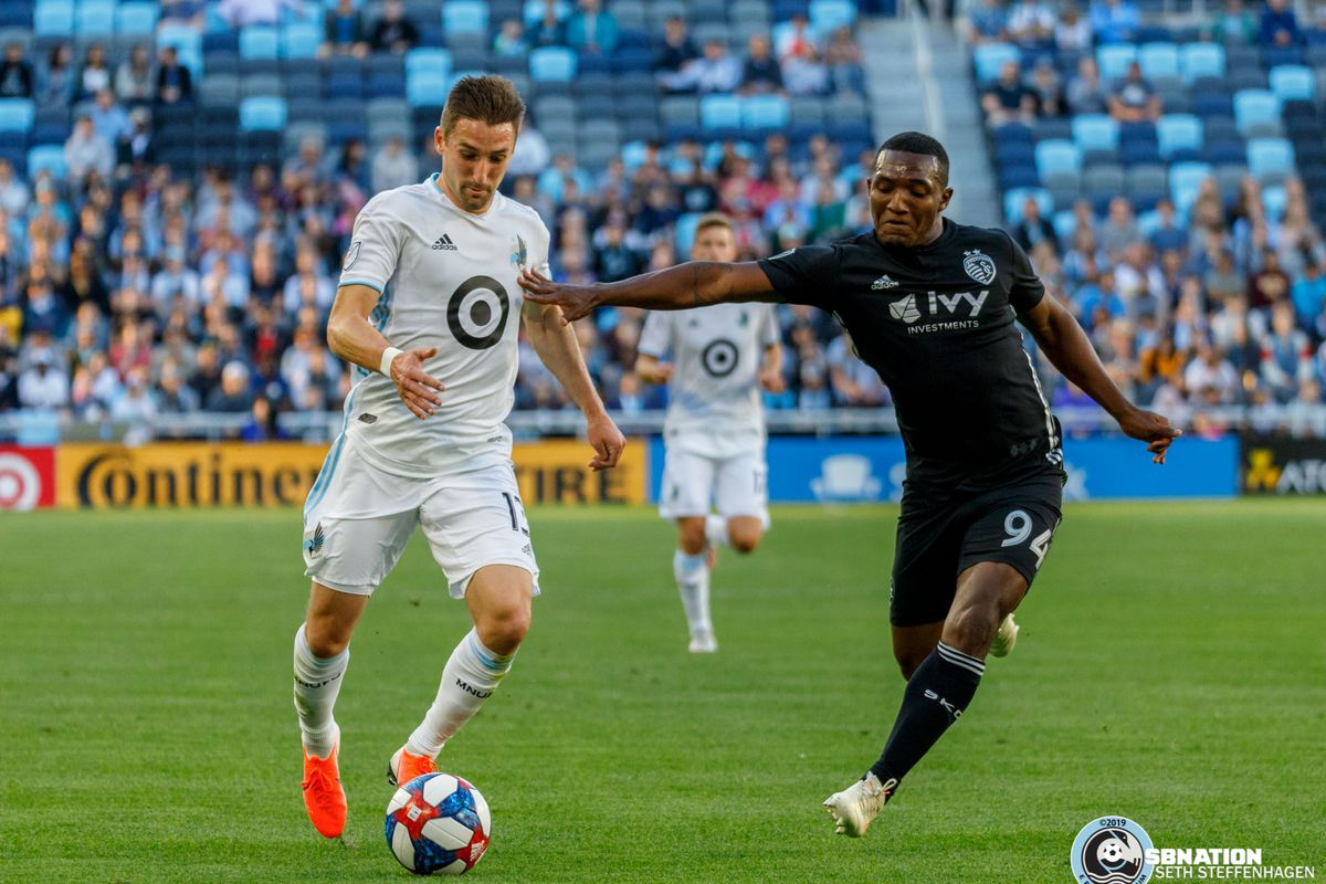 June 12, 2019 - Saint Paul, Minnesota, United States - Sporting KC defender Jimmy Medranda (94) looks to push Minnesota United midfielder Ethan Finlay (13) off the ball during the US Open Cup match between Minnesota United and Sporting KC at Allianz Field.