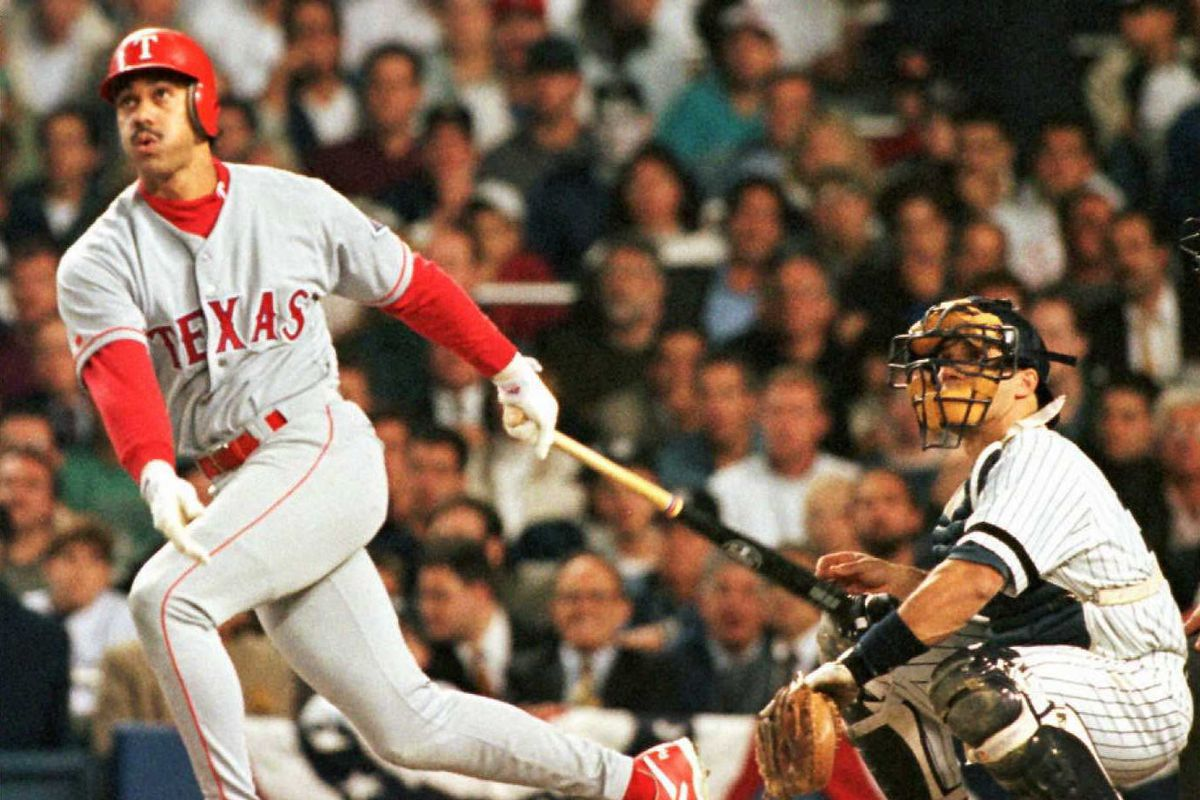 Texas Rangers' Juan Gonzalez watches his three-run