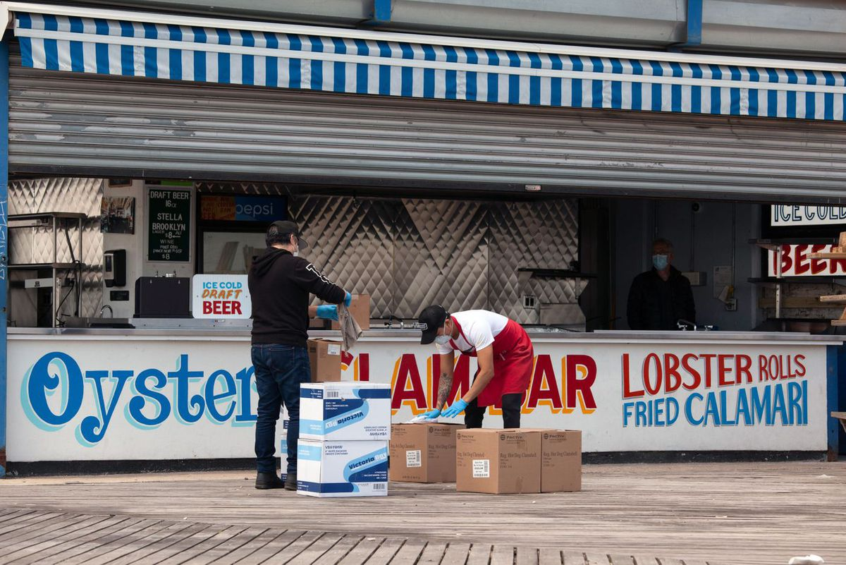 Workers clean supplies for the Paul's Daughter food stand at Coney Island.