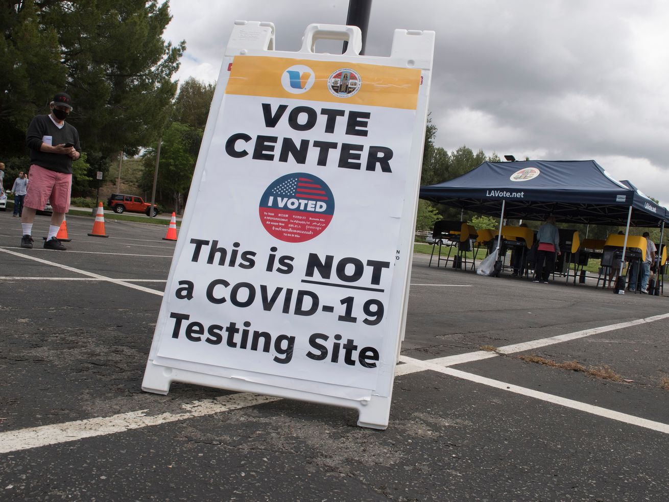 "A sign in a parking lot reads, ""Vote center. This is not a Covid-19 testing site."""
