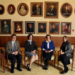 """Matt Grow, left, Kate Holbrook, Carol Cornwall Madsen, and Jill Mulvay Derr, co-editors of """"The First Fifty Years of Relief Society,"""" pose for a photo at the Relief Society Building in Salt Lake City, Monday, Feb. 22, 2016. Behind them are portraits of past Relief Society Presidents of The Church of Jesus Christ of Latter-day Saints."""