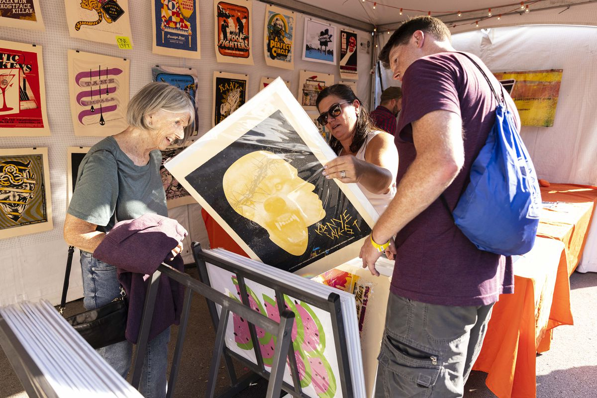 Festival-goers check out art by local artists on day one of the Pitchfork Music Festival, Friday, Sept. 10, 2021.