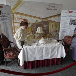 Sisters Terri Williamson, left and Tracie Brelsford from Washington state in the US pose for their photograph as they sit in a mock up of a first class dinning table from the Titanic  in the check in area for the MS Balmoral's Titanic memorial cruise in Southampton, England, Sunday, April  8, 2012. Nearly 100 years after the Titanic went down, a cruise with the same number of passengers aboard is setting sail to retrace the ship's voyage, including a visit to the location where it sank. The Titanic Memorial Cruise is set to depart Sunday from Southampton, where the Titanic left on its maiden voyage. The 12-night cruise will commemorate the 100th anniversary of the sinking of the White Star liner. With 1,309 passengers aboard, the MS Balmoral will follow the same route as the Titanic. Organizers are trying to recreate the onboard experience  minus the disaster  from the food to a band playing music from that era. Organizers said people from 28 countries have booked passage, including relatives of some of the more than 1,500 people who died when the Titanic collided with an iceberg and sank on April 15, 1912.