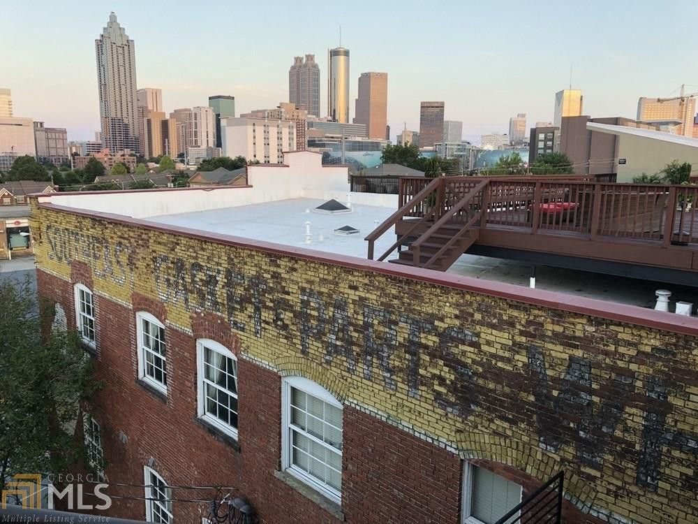A rooftop with a large deck and views across downtown Atlanta.