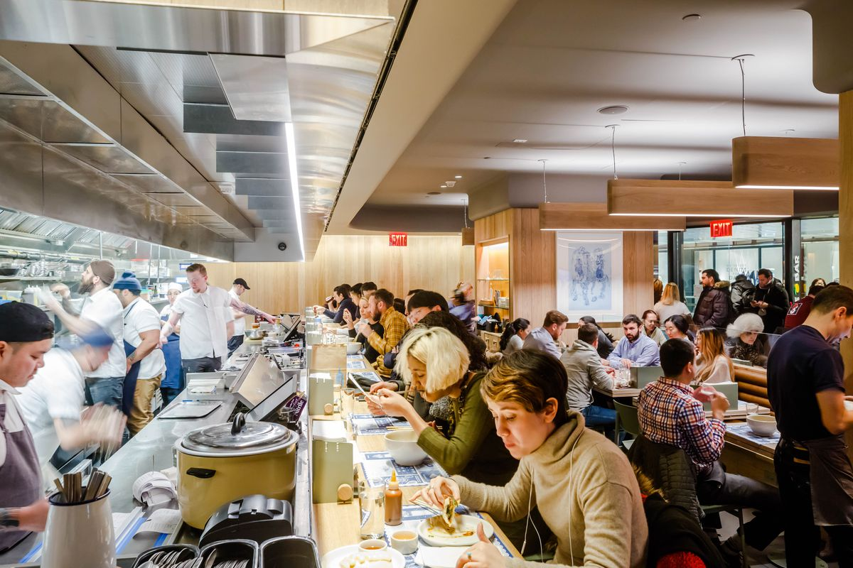 Patrons dine at the open kitchen