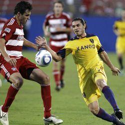 FC Dallas defender George John, left, is challenged by Real Salt Lake forward Fabian Espindola.