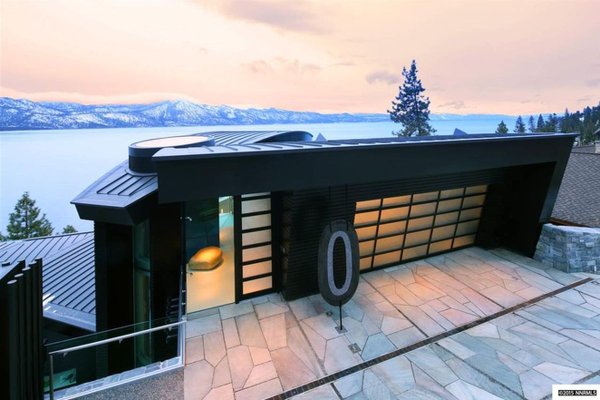 Exterior of Tahoe mansion with lake in the background.