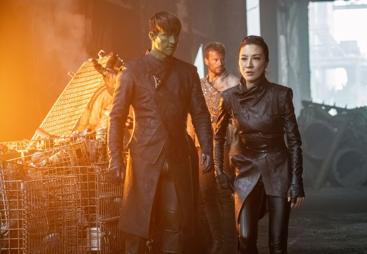 Georgiou walks past a pile of street junk in Star Trek: Discovery