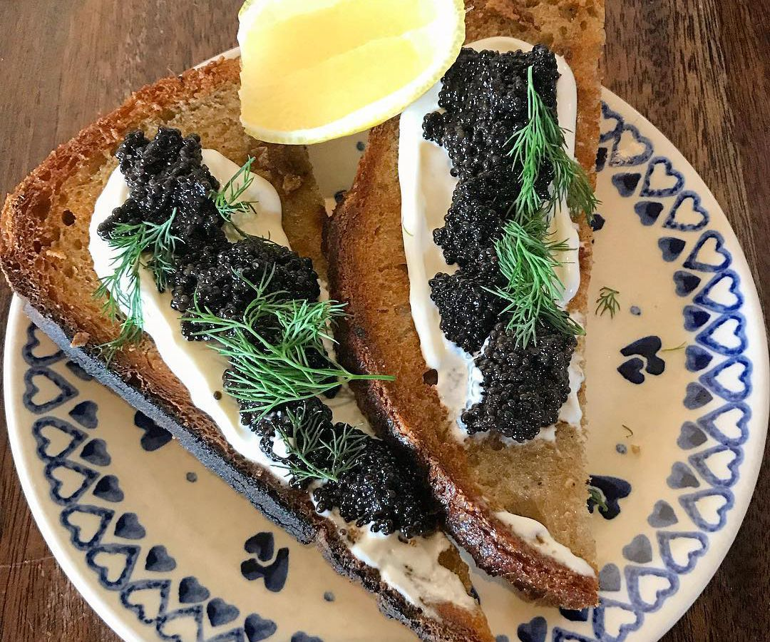 A plate of caviar toast.