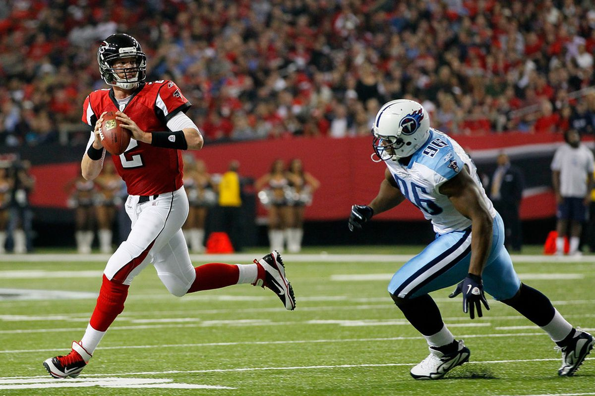 ATLANTA, GA - NOVEMBER 20:  Matt Ryan #2 of the Atlanta Falcons rolls out of the pocket against Malcolm Sheppard #96 of the Tennessee Titans at Georgia Dome on November 20, 2011 in Atlanta, Georgia.  (Photo by Kevin C. Cox/Getty Images)