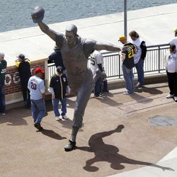 Baseball fans linger around the statue of Pittsburgh Pirates hall of fame second baseman Bill Mazeroski outside PNC Park before the start of the season opening baseball game between the Pittsburgh Pirates and the Philadelphia Phillies on Thursday, April 5, 2012, in Pittsburgh.
