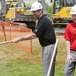 Men's coach Larry Krystowiak and women's coach Anthony Levrets join in on the turning over of the ground as the University of Utah breaks ground Monday, May 5, 2014 on the new Jon M. and Karen Huntsman Basketball Center.