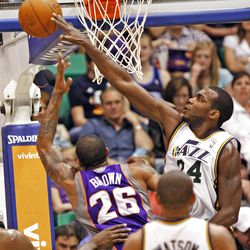 Utah's Paul Millsap blocks a shot by Sun's Shannon Brown as the Utah Jazz are defeated by the Phoenix Suns 107-105 as they play NBA basketball Wednesday, April 4, 2012, in Salt Lake City, Utah.
