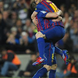 FC Barcelona's Lionel Messi, from Argentina, reacts after scoring a goal against Athletic Bilbao during a Spanish La Liga soccer match at the Camp Nou stadium in Barcelona, Spain, Saturday, March 31, 2012.