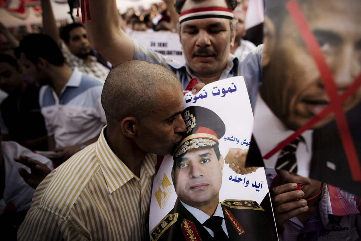 A man kisses a picture of then-Gen. Abdel Fattah el-Sisi as tens of thousands of people rallied in Tahrir Square against ousted President Mohamed Morsi in Cairo on July 7, 2013.