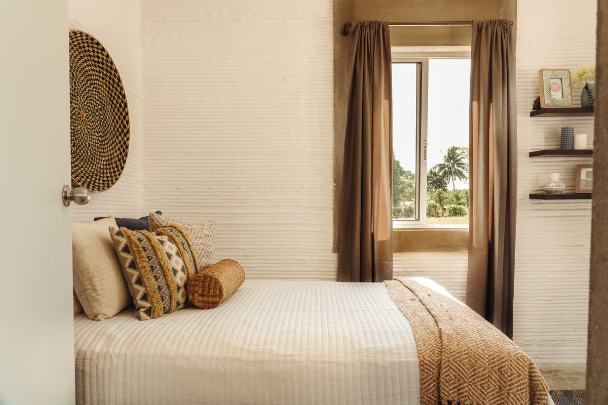 Bedroom outfitted in neutral colors.