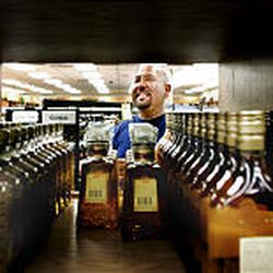 """Allan Valdez shops at a state liquor store in Salt Lake City. Utah's per-capita consumption is up 24 percent over the past decade, partly due to consumption of """"harder"""" alcoholic drinks."""