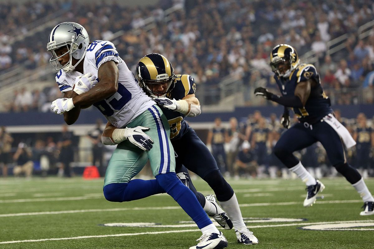 ARLINGTON, TX - AUGUST 25:    Kevin Ogletree #85 of the Dallas Cowboys runs the ball against  Craig Dahl #43 of the St. Louis Rams at Cowboys Stadium on August 25, 2012 in Arlington, Texas.  (Photo by Ronald Martinez/Getty Images)