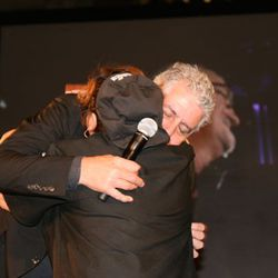 One of the students asks Bourdain for a hug. He complies.
