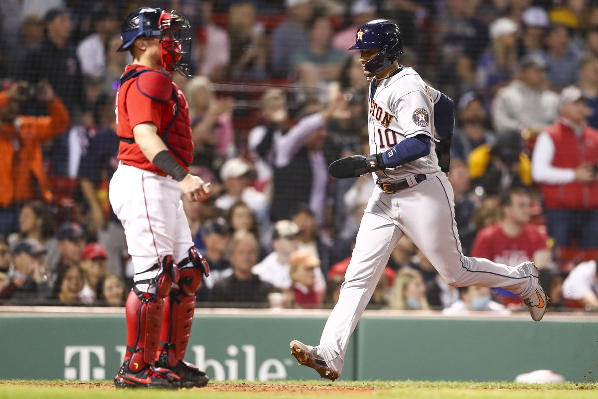 Yuli Gurriel #10 of the Houston Astros scores in the fifth inning of a game against the Boston Red Sox at Fenway Park on June 10, 2021 in Boston, Massachusetts.