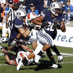 Brigham Young Cougars running back Joshua Quezada runs for a touchdown as Brigham Young University faces Idaho State in NCAA football in Provo, Saturday, Oct. 22, 2011.