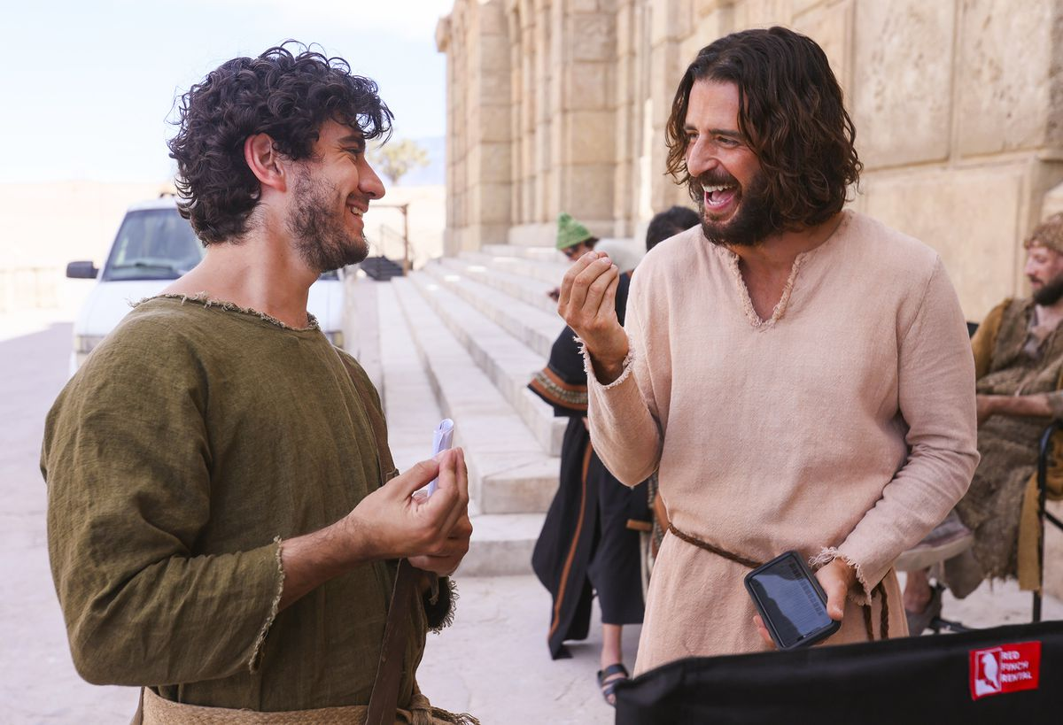 """George Harrison Xanthis, who plays John, laughs with Jonathan Roumie, who plays Jesus, during a pause in filming of a faith-based streaming series on the life of Christ called """"The Chosen"""" at The Church of Jesus Christ of Latter-day Saints' Jerusalem set in Goshen, Utah County, on Monday, Oct. 19, 2020."""