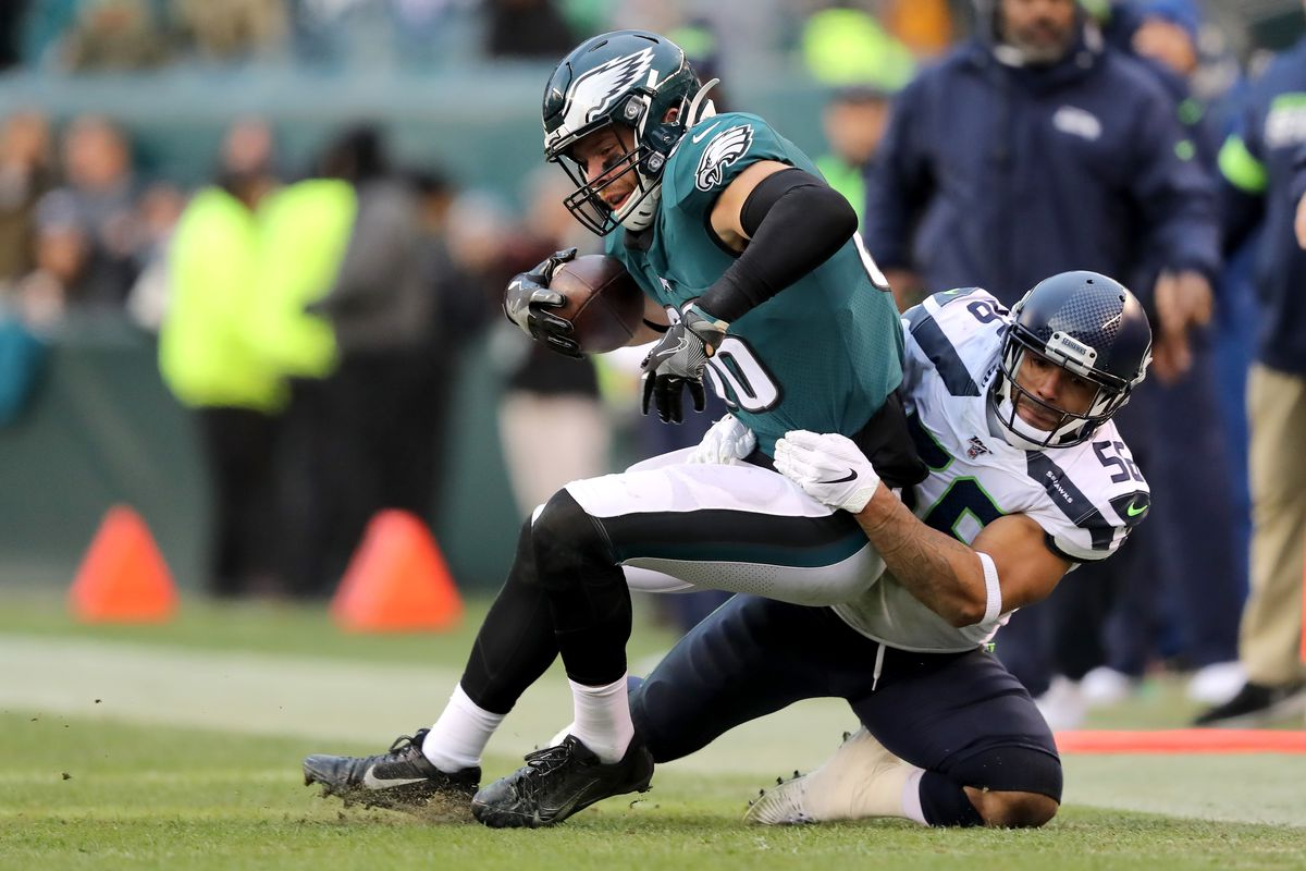 Zach Ertz of the Philadelphia Eagles is tackled by Mychal Kendricks of the Seattle Seahawks after making a catch in the second half at Lincoln Financial Field on November 24, 2019 in Philadelphia, Pennsylvania.