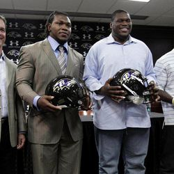 From left to right, Baltimore Ravens head coach John Harbaugh poses for a photo with defensive end/outside linebacker Courtney Upshaw, guard/tackle Kelechi Osemele and running back Bernard Pierce during a news conference to introduce the Raven's NFL football draft picks at the team's training facility in Owings Mills, Md., Saturday, April 28, 2012.