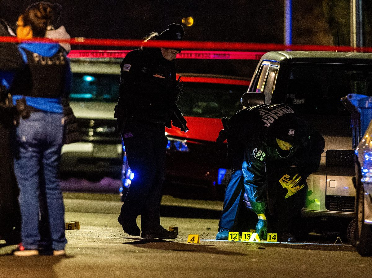 Police investigate the scene where two teenage women were shot to death Monday night in the 7700 block of South Eggleston.   Tyler LaRiviere/Sun-Times