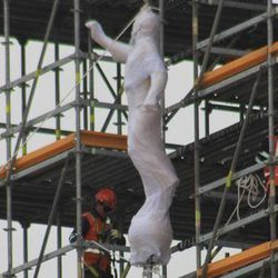 The Angel Moroni statue is lifted to the top of the Trujillo Peru Temple.