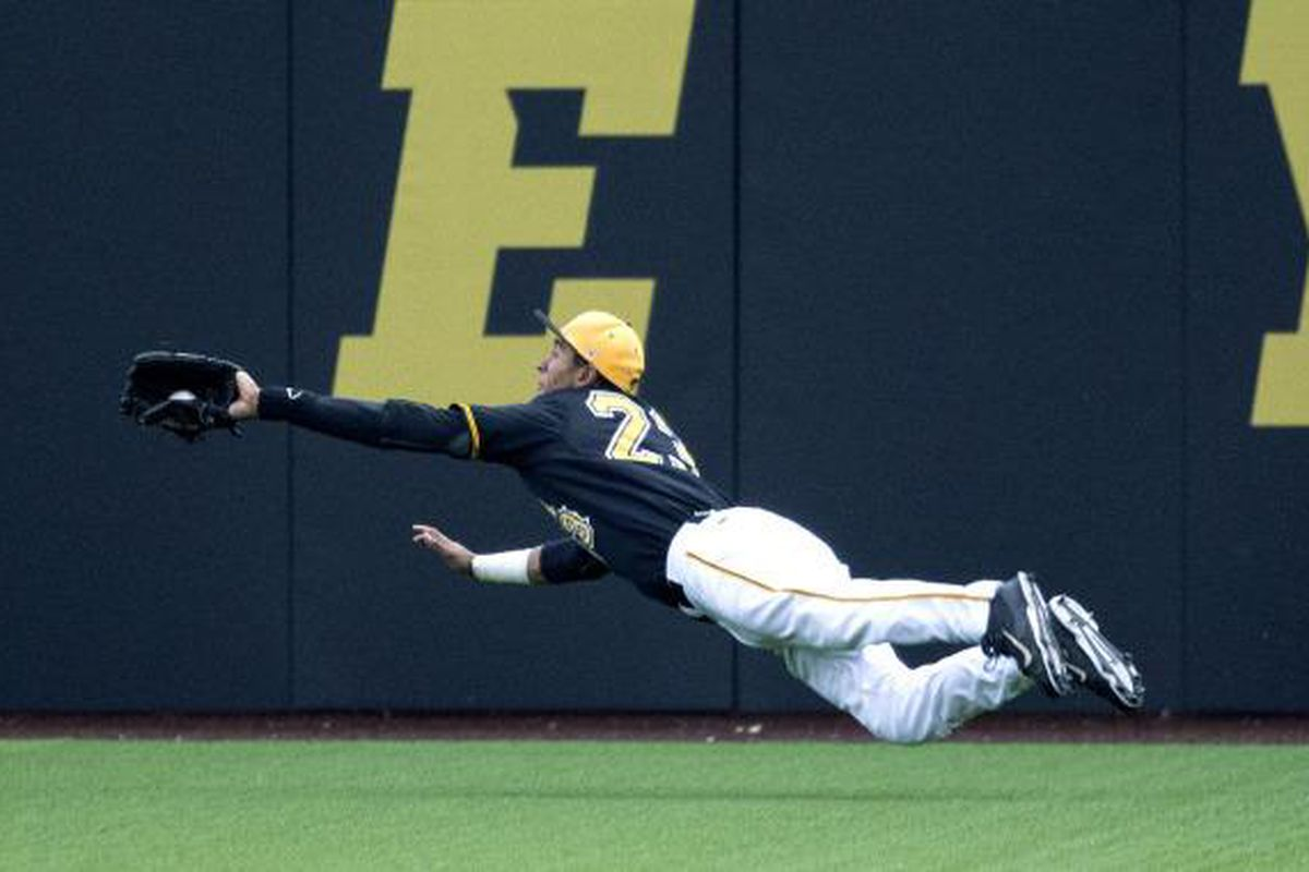Iowa RF Joel Booker robs Nebraska DH of a possible game-tying extra-base hit in the 9th.