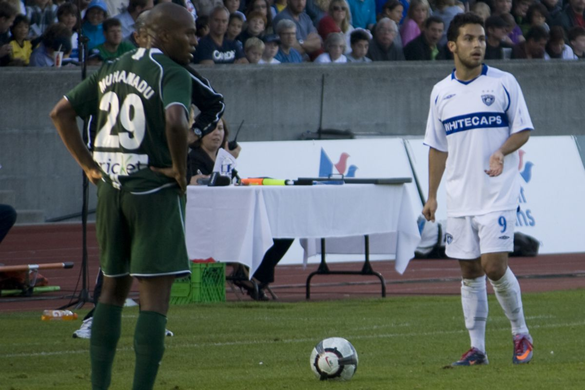 Davide Chiumiento of the Vancouver Whitecaps and Ibad Muhamadu of the Portland Timbers square off in one of the final second division Cascadia Cup matches during the 2010 season. (Benjamin Massey/Eighty Six Forever)